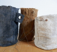 Ground Cloth Object: 3 Vessels, Linen, wire, hand-collected and hand-Ground Cloth Object: 3 Vessels, ground chalk, hand-collected and hand-ground yellow clay, hand-collected and hand-ground seacoal, sea water.