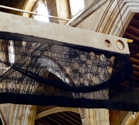 Sluice Creek Cloth: Curlew Song hanging in St. Margaret's Church, Cley-next-the-Sea, Norfolk, linen, wire, 320 x 150 cms