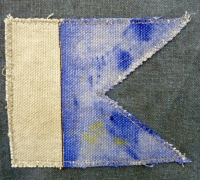 The Signalman, Flag 3 (detail, Flag 'U'): Night action Fires started. Flames engulfed the forebridge. Signal method: Flags Linen, cotton duck, cotton, brass